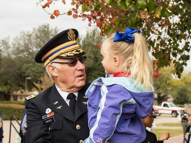 veteran and child at parade