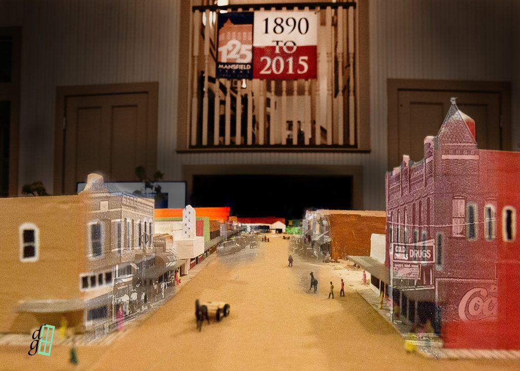 View of the Model, Looking down Main Street, with Portions of a Period Photograph Superimposed on th