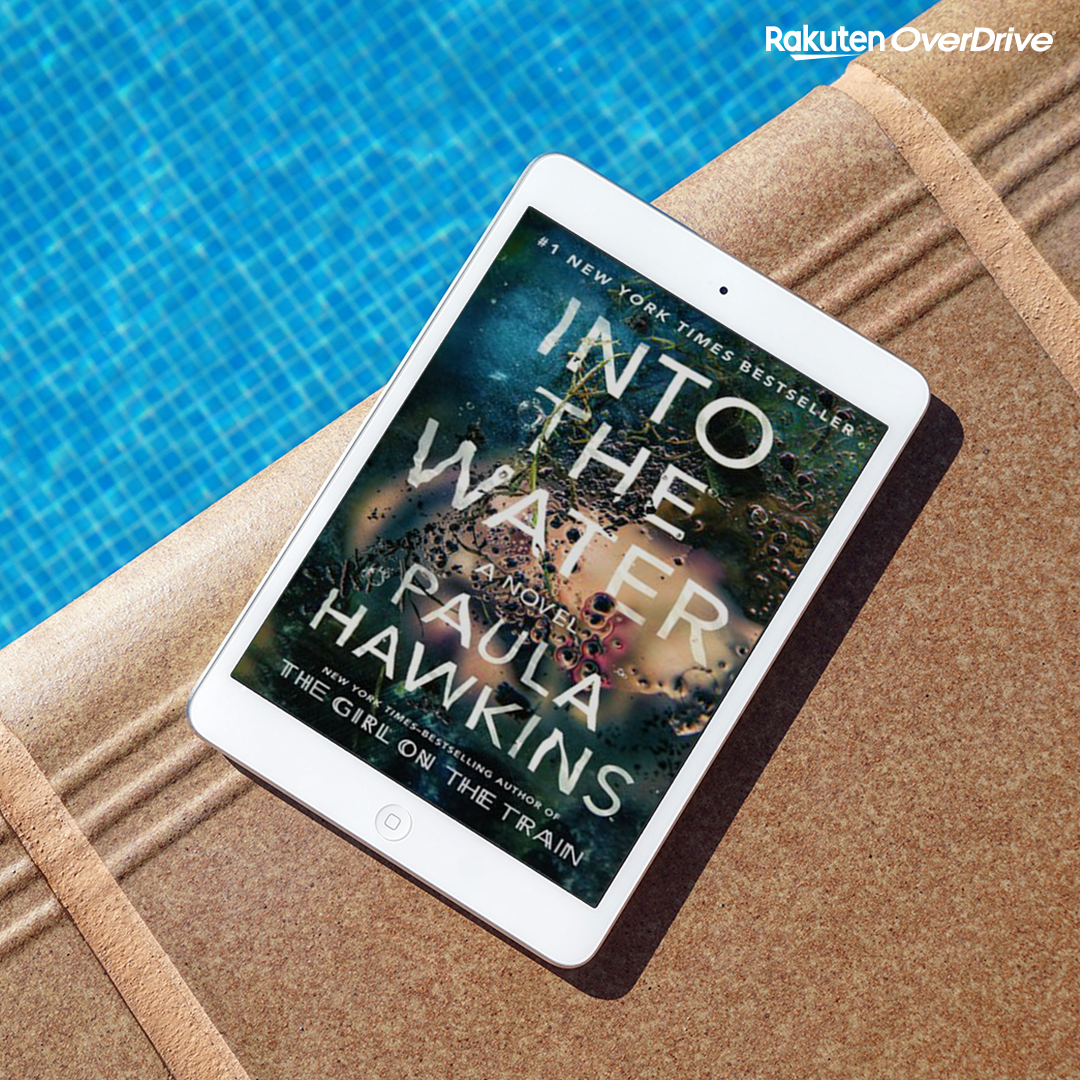 Overdrive Image of Into the Water, tablet next to the pool displaying book