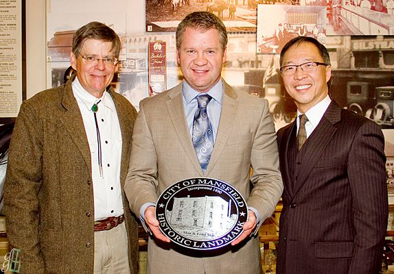 Dr. Robert Smith (Left) and Felix Wong (Right) Present Mayor David Cook with a Plaque for the Historic House Where the Mayor Has His Offices